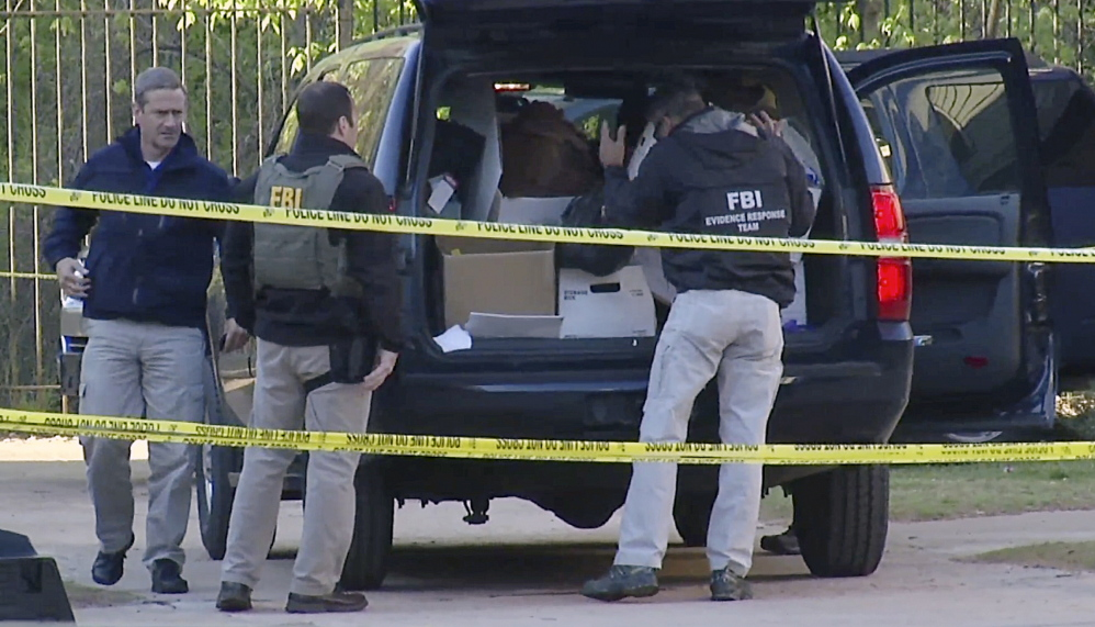 FBI agents collect evidence at an apartment complex on April 10 in Atlanta, Ga., where federal agents rescued kidnap victim Frank Arthur Janssen of Wake Forest. N.C.