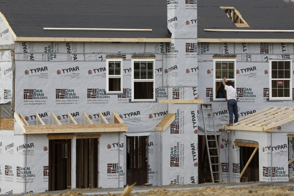 Construction continues in March on housing in Zelienople, Pa. Rising prices and higher mortgage rates have made it harder for many Americans to afford a home.