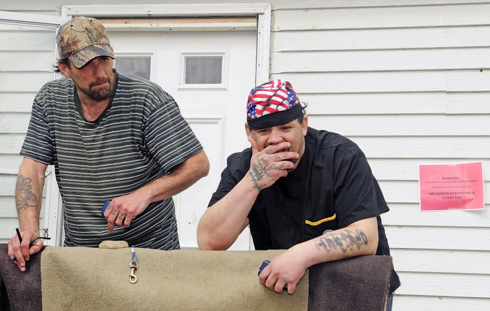 "Tyson Joseph Goldstein, left, and Brett Hollowell Sr. discuss what they might do if they're evicted from Meadowbrook Trailer Park in Richmond. ""I'm clueless, literally clueless,"" Hollowell said. Water to the park was shut off Tuesday morning."