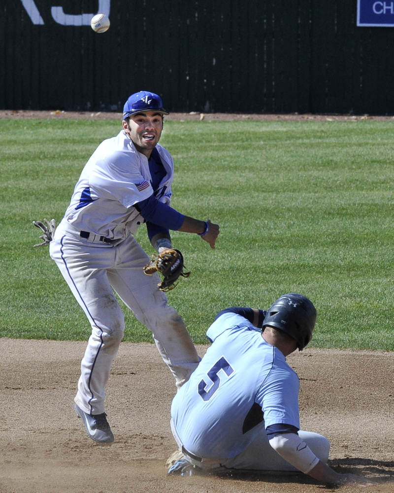 Zach Graham of St. Joseph's makes an attempt for a double play after forcing Chris Pittman at second base. The throw was late but no matter, the Monks advanced at home in the four-team, double-elimination tournament.