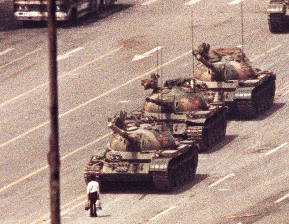 A man stands in front of a convoy of tanks in the Avenue of Eternal Peace in Beijing on June 5, 1989. The photo, by Jeff Widener, who was working for The Associated Press, was one of a handful that captured the moment.
