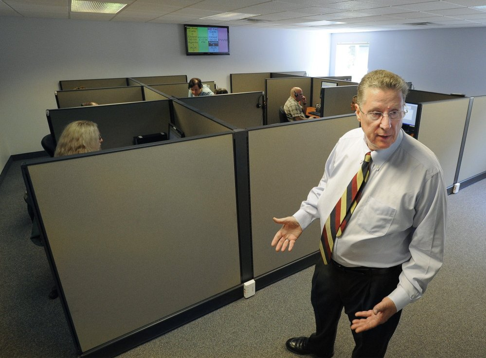 LogistiCare Vice President Bob Harrison, shown at the Kennebunk call center in 2013, says the company learned from its mistakes and will be able to expand to other regions of the state without the same problems it had last year in York County.