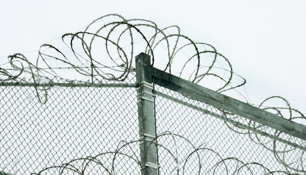 Razor wire is coiled along the top of the security fence at the Maine State Prison in Warren. State officials have made substantial improvements to policies on the use of segregation to punish disruptive inmates.
