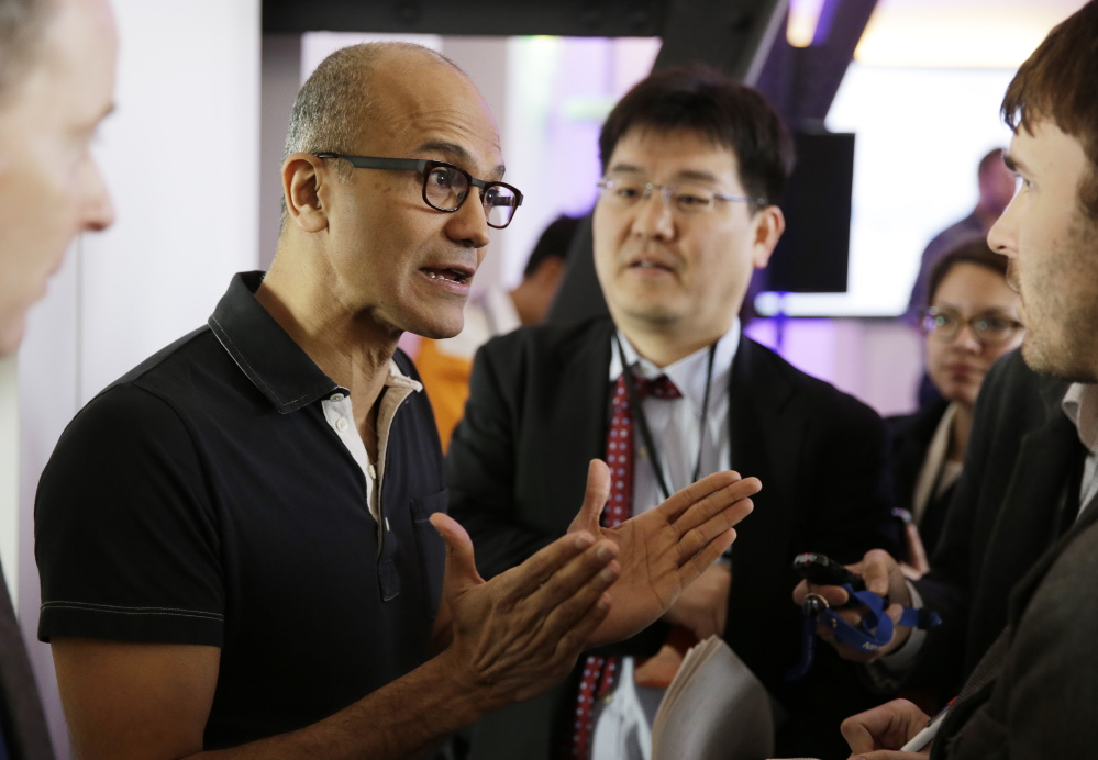 Microsoft CEO Satya Nadella, who replaced longtime CEO Steve Ballmer in February, gestures while speaking with reporters after giving a news briefing on the intersection of cloud and mobile computing on March 27 in San Francisco.