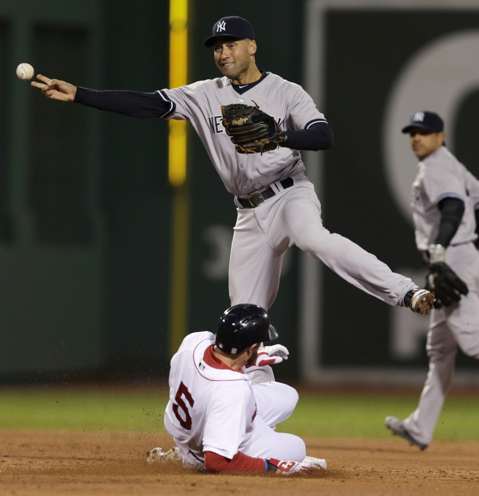 Yankees shortstop Derek Jeter makes the force-out on Boston's Jonny Gomes on a single hit by Xander Bogaerts in the second inning.