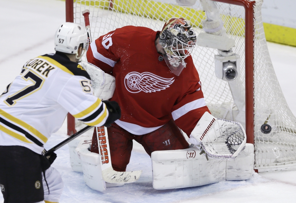 Detroit Red Wings goalie Jonas Gustavsson deflects a shot by Boston Bruins left wing Justin Florek in the third period of Game 4 of first-round NHL playoff series in Detroit on Thursday.