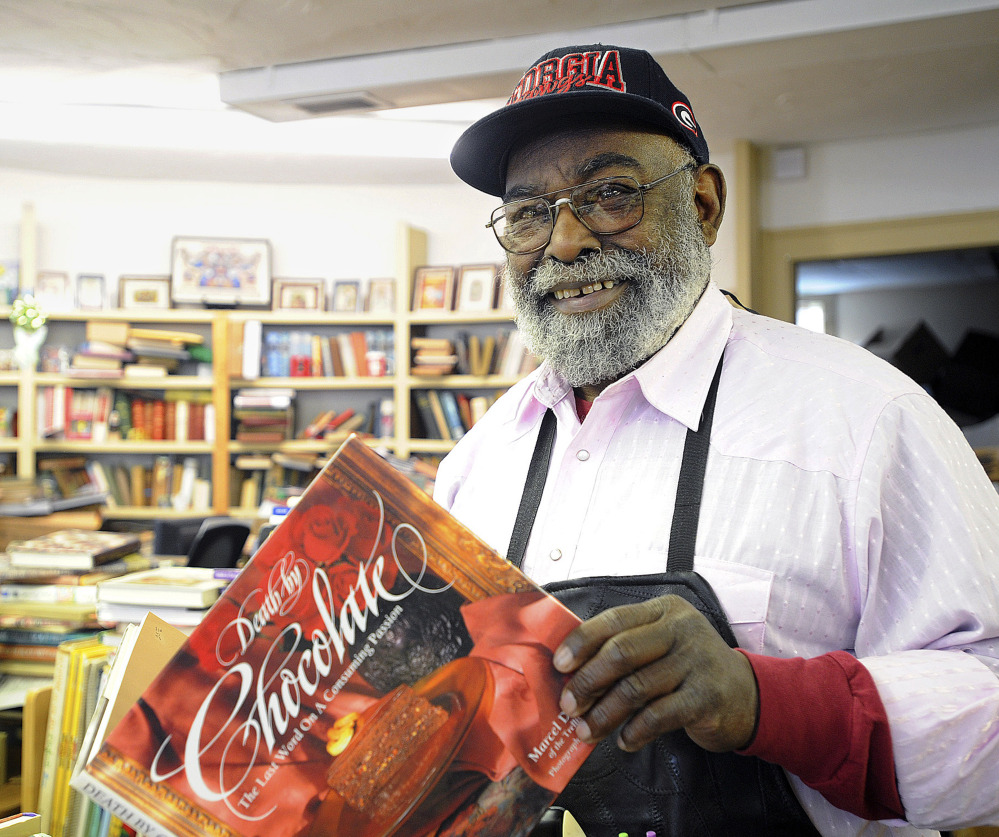 Eagle Trading Co. owner Chuck Williams holds one of his favorite old cookbooks at his store in Assonet, Mass. He and his store are solely devoted to finding and selling out-of-print and hard-to-find cookbooks.