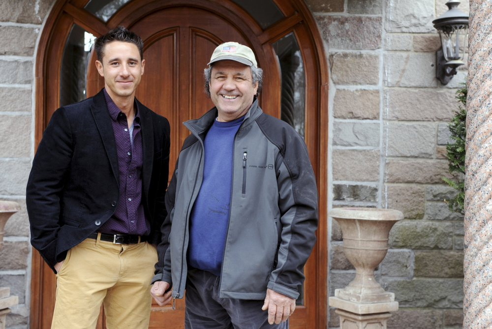 Father and son Dominico, right, and Joseph Schinella stand outside Dominico's home in Stamford, Conn. on April 7. Joseph is a real estate agent and his dad is a developer who worked his way up in the worlds of building and development.