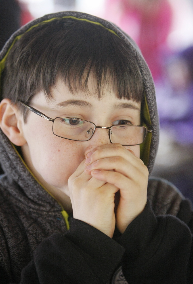 Elliot Timblin, 9, of Harpswell demonstrates his best duck call while listening to and learning about birdcalls at Bradbury Mountain State Park in Pownal on Saturday.