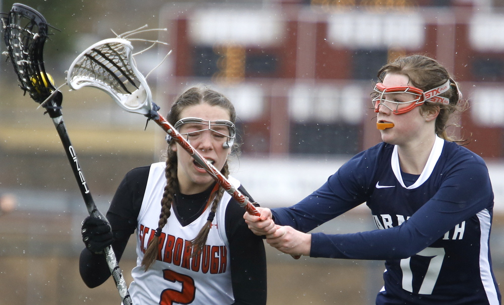 Abby Corbin, left, of Scarborough tries to get past Yarmouth's Mary Coyne. The Red Storm avenged a loss in last year's season opener.