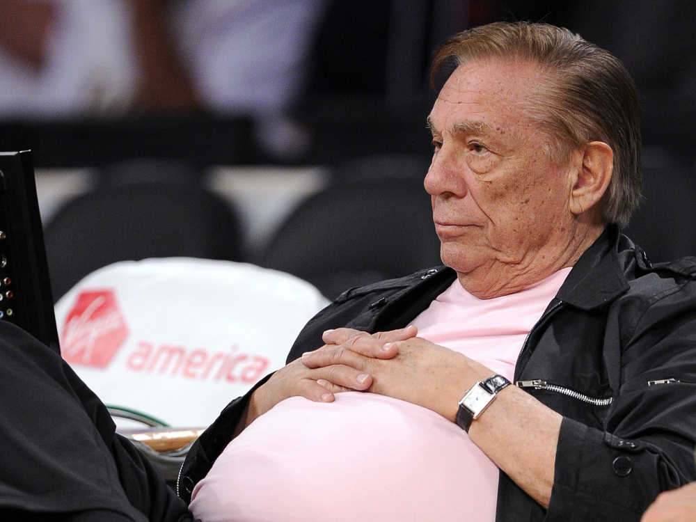 "In this Oct. 17, 2010 file photo, Los Angeles Clippers team owner Donald Sterling watches his team play in Los Angeles. The NBA is investigating a report of an audio recording in which a man purported to be Sterling makes racist remarks while speaking to his girlfriend. NBA spokesman Mike Bass said in a statement Saturday, APril 26, 2014, that the league is in the process of authenticating the validity of the recording posted on TMZ's website. Bass called the comments ""disturbing and offensive."""