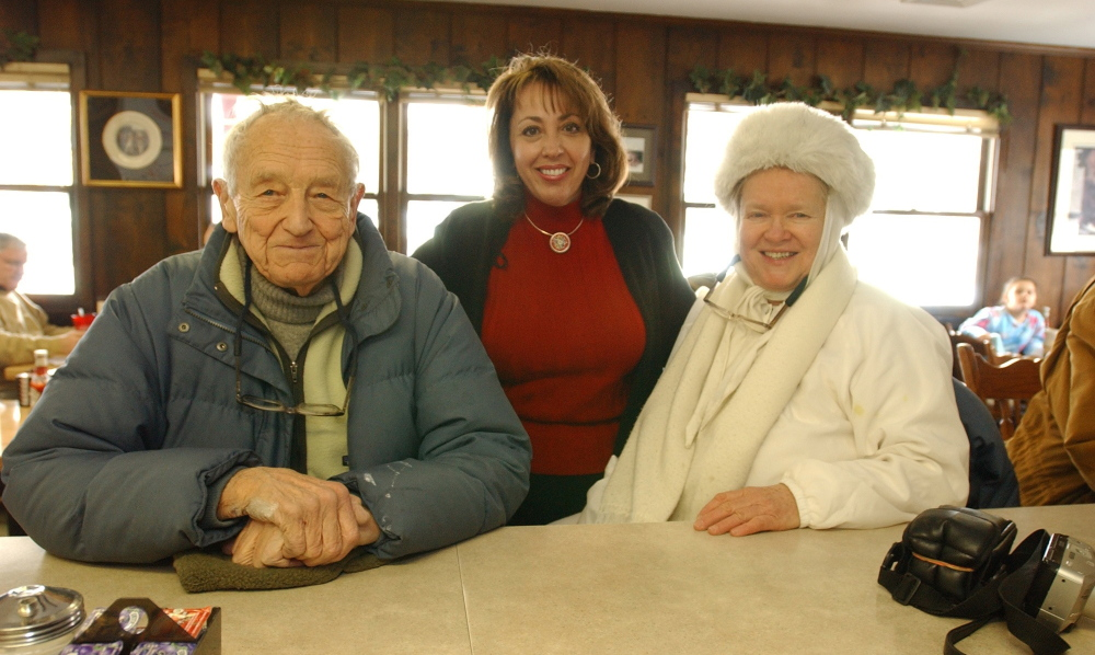 Artist Andrew Wyeth, shown with Helga Testorf, right, and Hank's Place co-owner Voula Skiadas center, in Chadds Ford, Pa., in 2003.