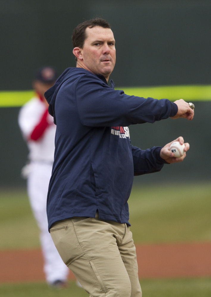 Former Red Sox right fielder Trot Nixon throws out the first pitch for the Portland Sea Dogs at Hadlock Field on Monday. Portland got a strong outing from Mike McCarthy, who won his first game of the year.