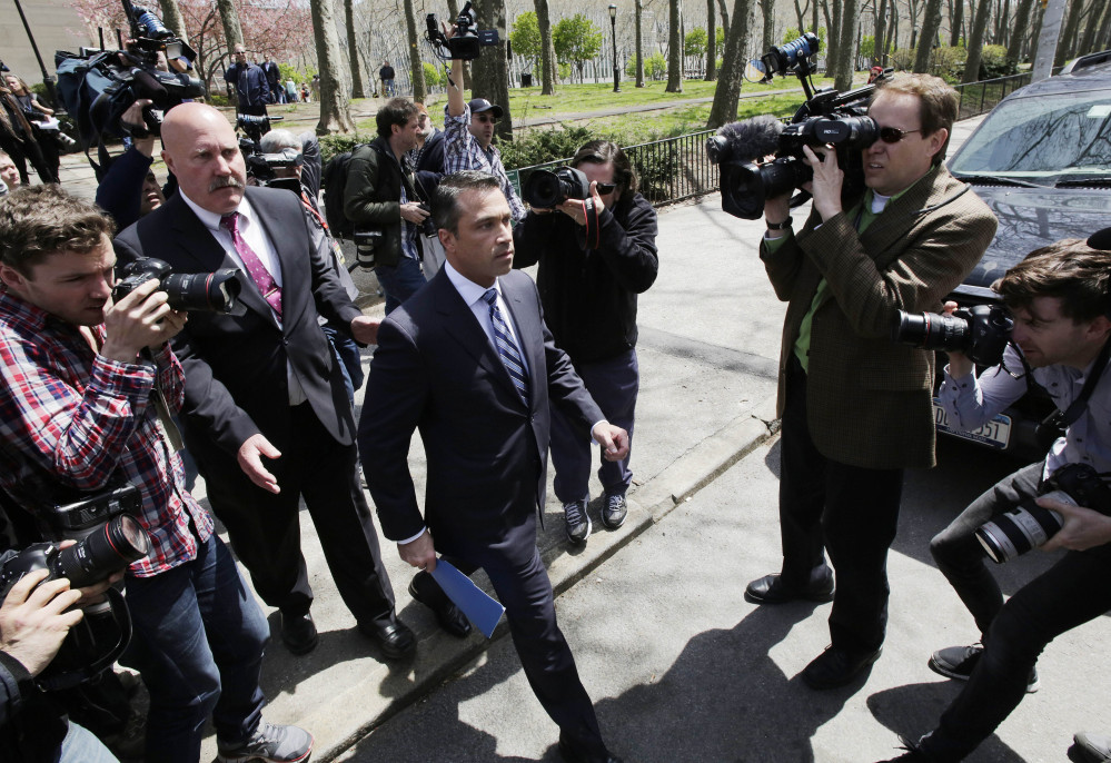 U.S. Rep. Michael Grimm leaves a news conference in a park next to federal court on Monday in Brooklyn.