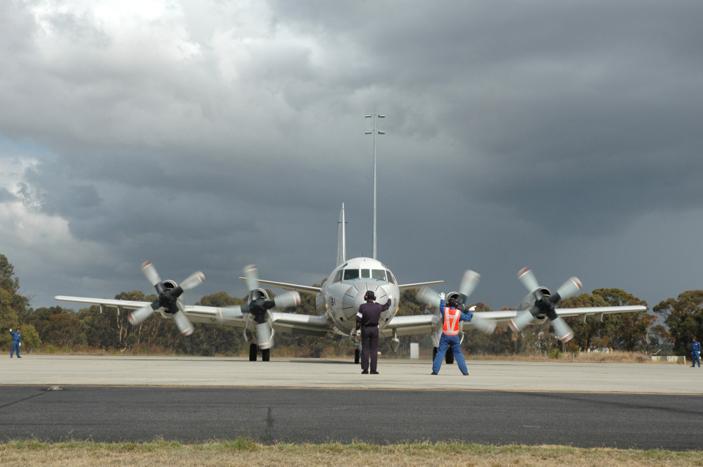 A Japanese P-3C Orion is guided by ground crew as it taxis along the tarmac at RAAF Base Pearce before departing on Japan's final search flight for the missing Malaysia Airlines flight on Monday.