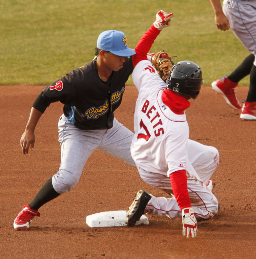 Fightin Phils second baseman Edgar Duran tags out Sea Dogs runner Mookie Betts while stealing at Hadlock Field in Portland on Tuesday.