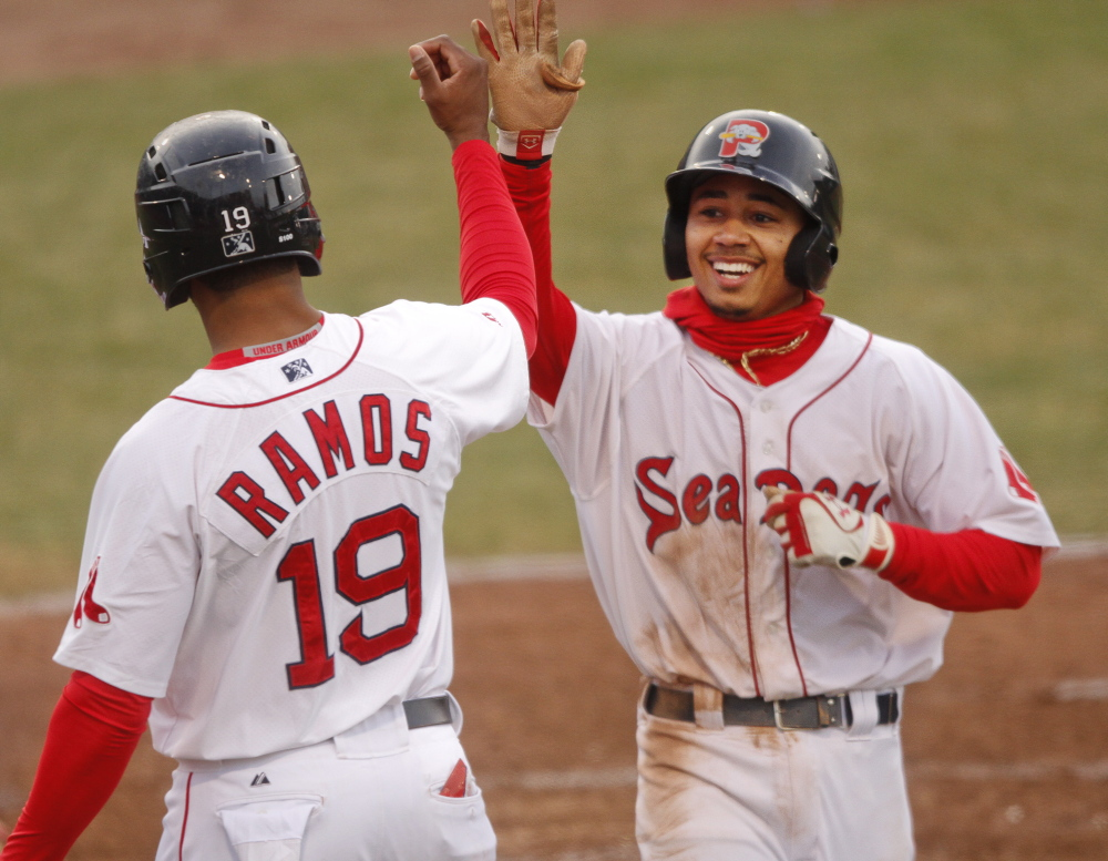 Mookie Betts high-fives Henry Ramos as he crosses home plate with a three-run homer in the fourth inning against the Reading Fightin Phils at Hadlock Field in Portland on May 13.