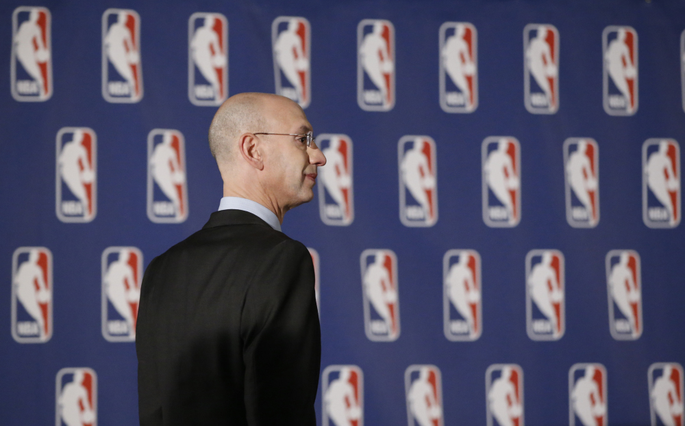 NBA Commissioner Adam Silver arrives at news conference in New York, Tuesday, April 29, 2014. Silver announced that Los Angeles Clippers owner Donald Sterling has been banned for life by the league, in response to racist comments the league says he made in a recorded conversation.