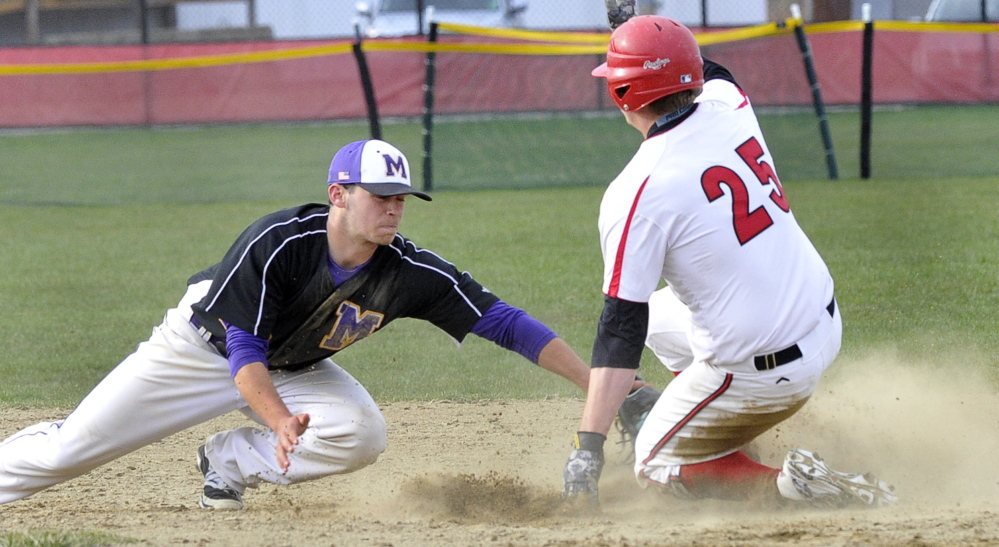 Noah McDaniel of Marshwood makes a late tag Tuesday as Ben Greenberg of Scarborough slides safely into second base with a steal. Marshwood won, 4-2.