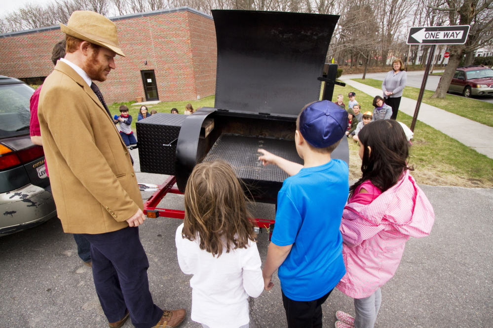 Herzfeld and students examine the kosher smoker.