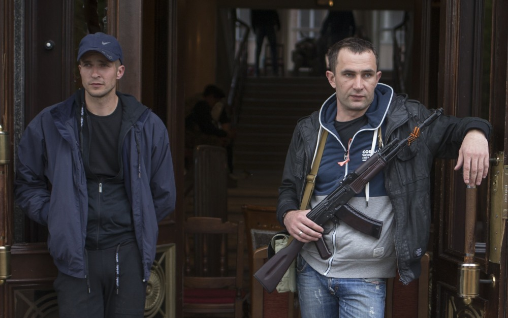 Pro-Russian activists guard the captured administration building in the center of Luhansk, Ukraine on Tuesday.