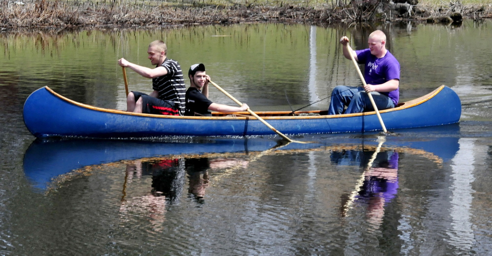 Staff photo by David LeamingLIQUID ICE: Ice has gone from most lakes and streams, including Messalonkee Stream in Waterville, and Bobby Perkins, left, Austin Hartin and Bruce Moody enjoyed the change.