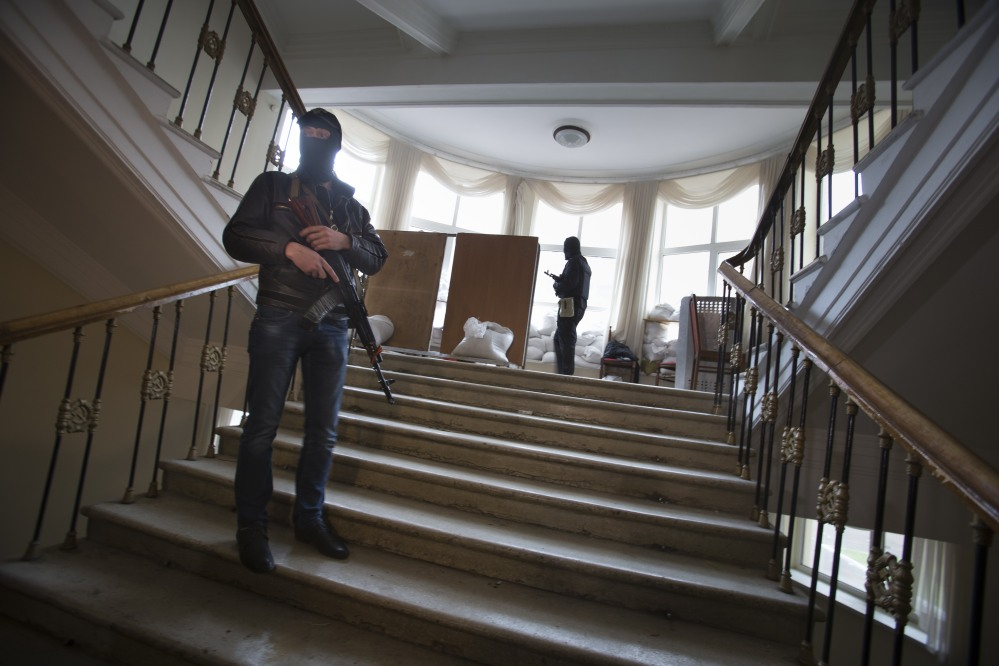 Pro-Russian gunmen guard an administration building they seized Tuesday in Luhansk, one of the largest cities in eastern, Ukraine,