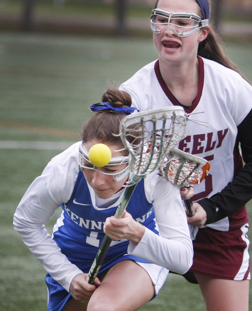Sophie Joseph of Kennebunk works to gain possession in front of Eliza McKenney of Greely during the first half at North Yarmouth Academy. Kennebunk opened a 7-2 halftime lead and never was seriously threatened.
