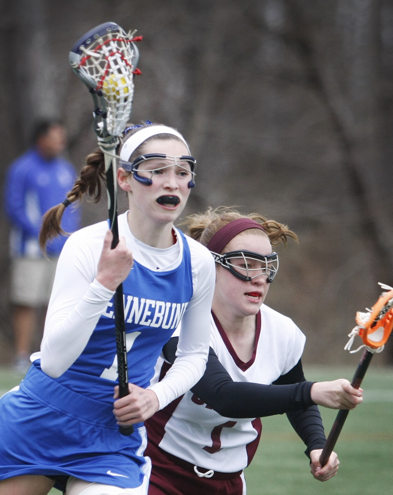 Jenny Bush, defended by Maggie Reed of Greely, played an instrumental role in Kennebunk's 8-3 victory against the Rangers in a girls' lacrosse game Wednesday, showing her ability to win draws.