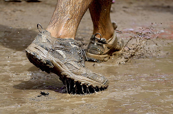 A runner splashes his way through the Mud Challenge course. Participants came from across the state, many wearing elaborate get-ups in hopes of winning the costume contest.