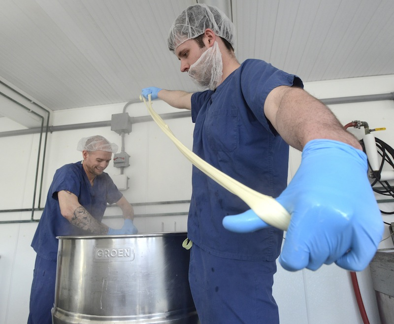 Cheesemakers Kris Burleigh and Tyler Renaud make a mexican oaxaca cheese at Silver Moon Creamery in Westbrook on April 10, 2014.