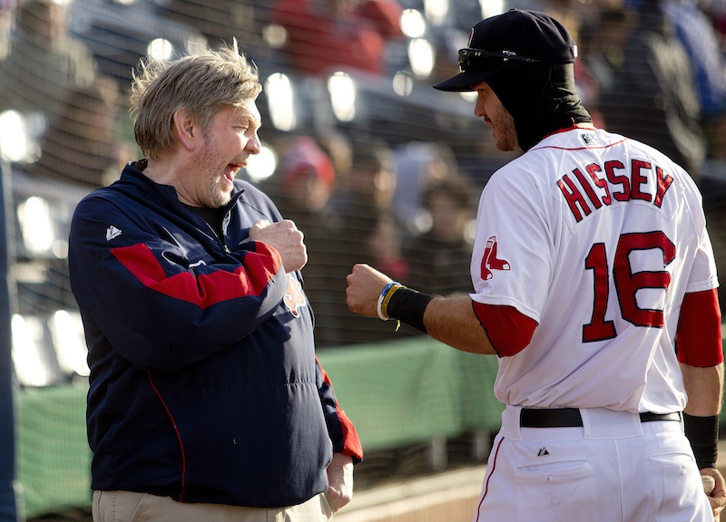 Craig Candage, clubhouse manager for the Portland Sea Dogs, shares a laugh with outfielder Peter Hissey before the start of Portland's home opener at Hadlock Field, Thursday, April 10, 2014.