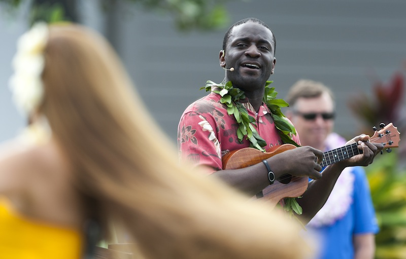 In this January 2014 file photo, a hula dancer plays a ukulele before the start of a golf tournament in Kapalua, Hawaii. Hawaii is debating whether to make the ukulele or the steel guitar it state instrument.
