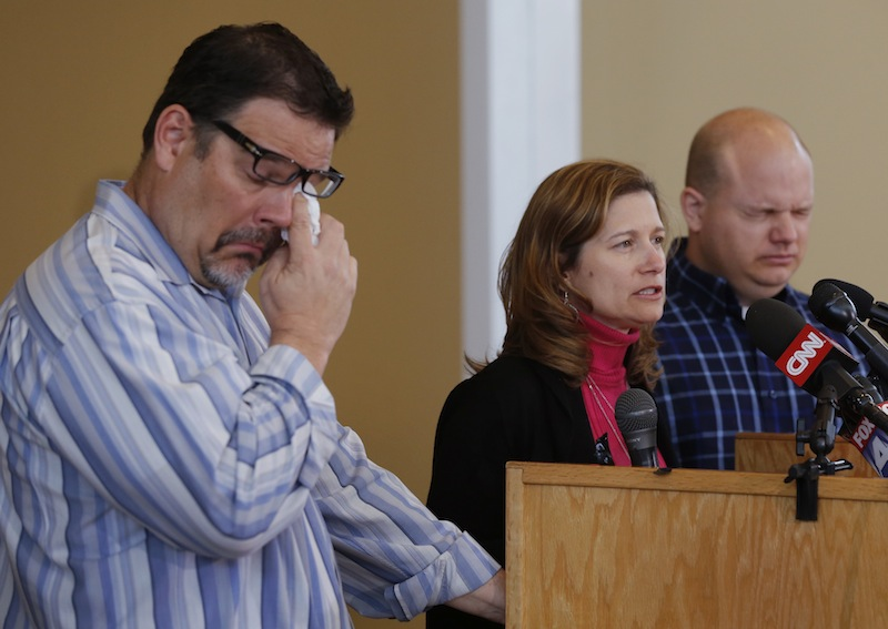 Will Corporon, left, and Tony Corporon, right, fight emotions while Mindy Losen, center, talks about her son and father during a news conference at their church in Leawood, Kan., Monday, April 14, 2014. Dr. William Corporon and his 14-year-old grandson were victims of Sunday's shooting at the Jewish Community Center. The three are sons and daughter of Dr. Corporon and Losen is the mother of the 14-year-old victim.