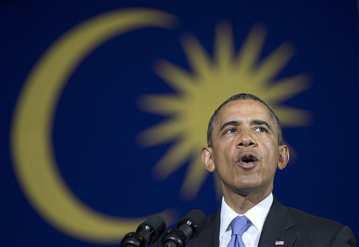 With a Malaysian flag behind him, President Obama speaks during a town hall meeting at Malaya University in Kuala Lumpur, Malaysia, on Sunday.
