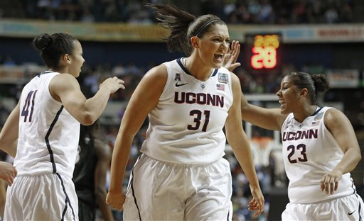 Connecticut center Stefanie Dolson celebrates during the first half of the semifinal game against Stanford in the Final Four tournament Sunday in Nashville.