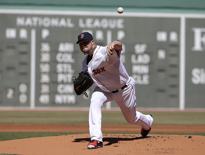 Boston Red Sox's Jon Lester delivers a pitch against the Milwaukee Brewers in the first inning of Sunday's game in Boston.