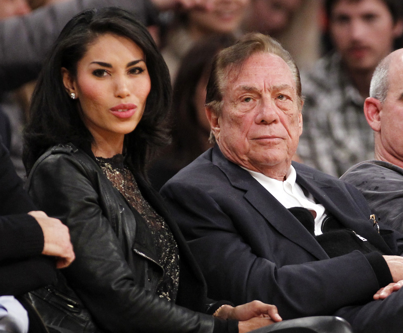 Los Angeles Clippers owner Donald Sterling sits with V. Stiviano at a Clippers game. Sterling was talking to Stiviano when he was recorded making racist remarks.