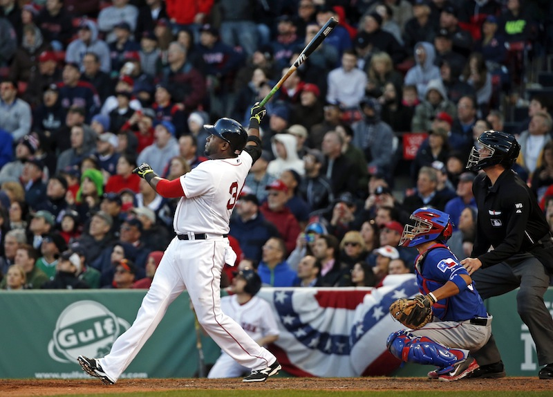 Boston's David Ortiz watches his three-run homer in front of Texas catcher Robinson Chirinos during the eighth inning at Fenway Park on Wednesday, April 9, 2014. The Red Sox won 4-2 thanks to the home run.