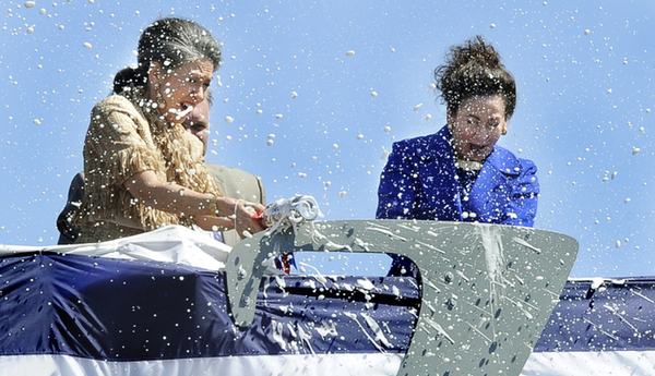 Adm. Elmo Zumwalt's daughters, Ann Zumwalt and Mouzetta Zumwalt-Weathers, break champagne bottles during the christening of the USS Zumwalt at Bath Iron Works in Bath on Saturday.