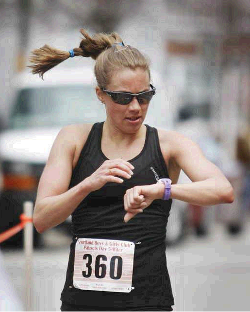 Michelle Lilienthal of Portland checks her time after finishing first for the women in the Portland Boys & Girls Clubs Patriots Day 5-miler road race in Portland on Monday.