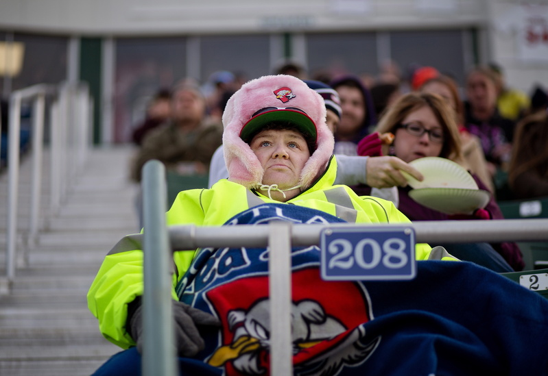 Pam Brown of Westbrook, a season ticket holder, was ready for the chilly temperatures at the season opener for the Portland Sea Dogs at Hadlock Field Thursday, April 10, 2014.