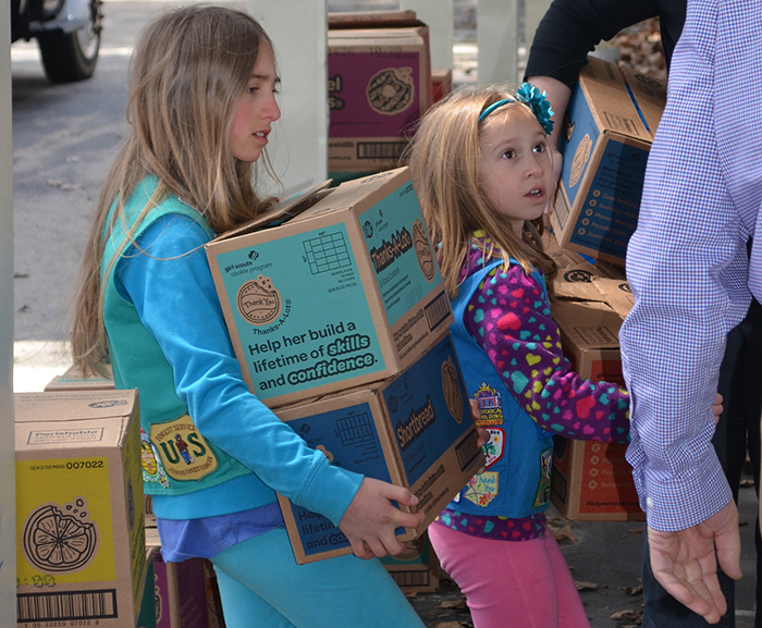 Girl Scouts Ella and Lillian Denis help deliver cookie orders following a cookie drive benefiting Meals on Wheels recipients in York and Cumberland counties as part of the Girl Scouts Cookie Share initiative.