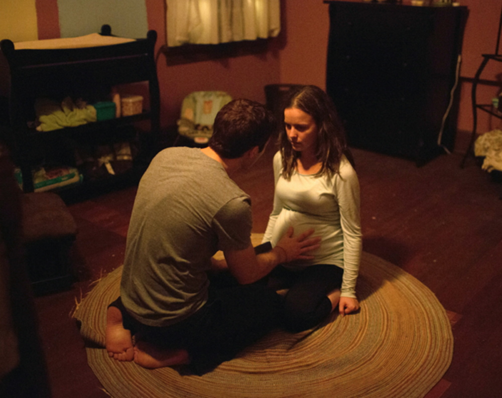 "Alison Miller and Zach Gilford in ""Devil's Due."""