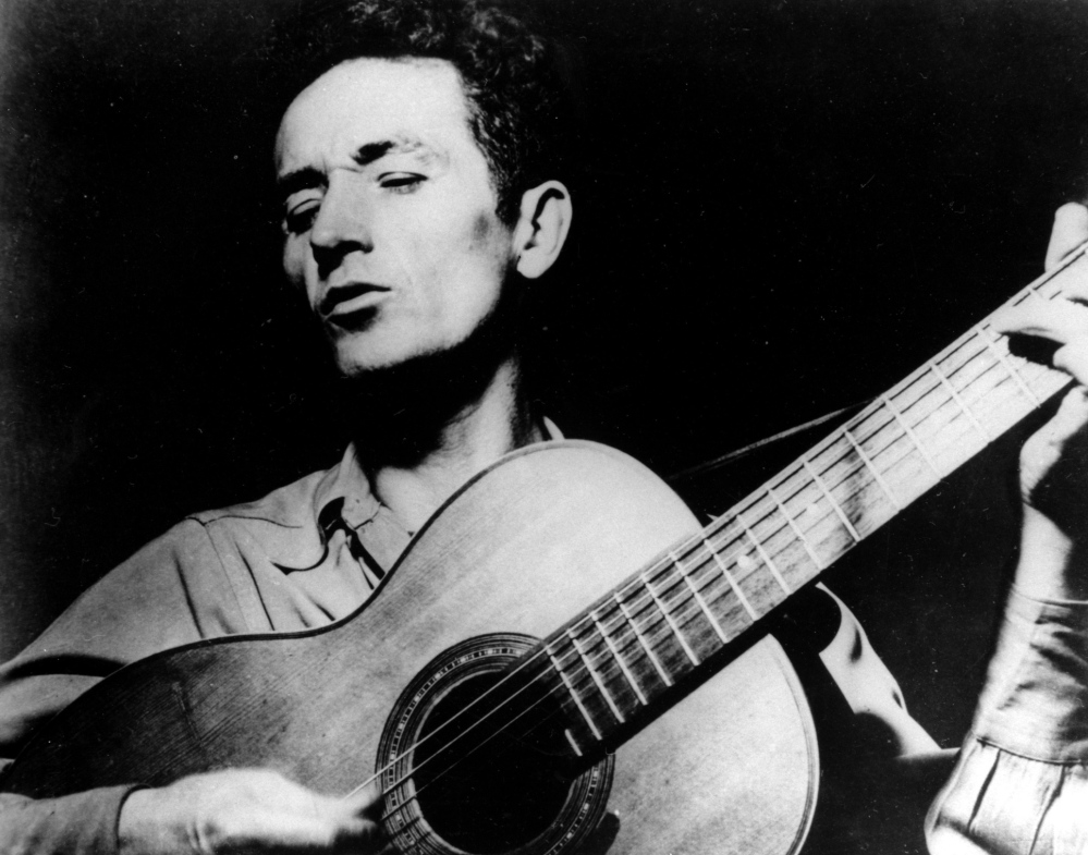 Eight guitars made from wood salvaged from Woody Guthrie's childhood home will be auctioned on eBay Thursday to benefit the rebuilding of the home.