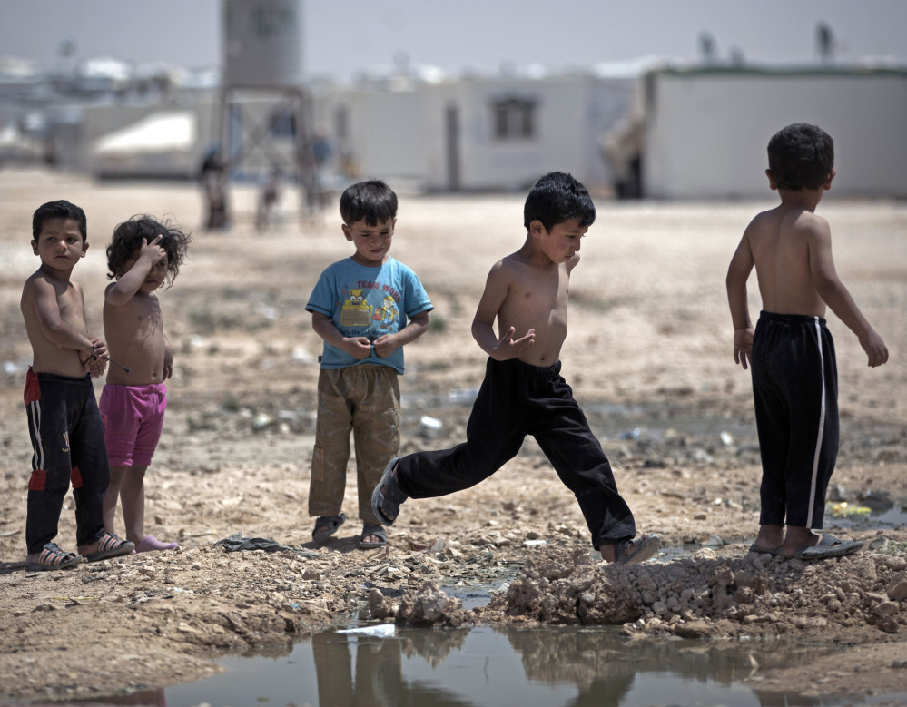 Syrian children play in the heat of the midday sun at Zaatari refugee camp, near the Syrian border in Jordan on April 17.