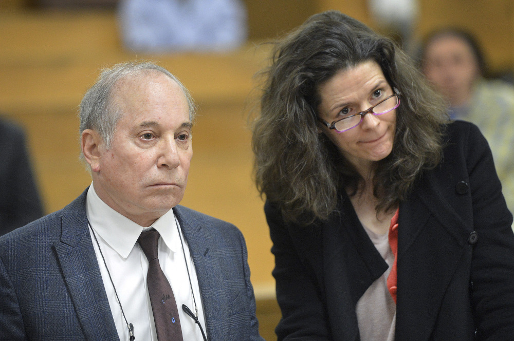 Singer Paul Simon and his wife, Edie Brickell, appear at a hearing in Norwalk Superior Court on Monday in Norwalk, Conn. Simon made the 911 call that brought police to their home, according to a police report.