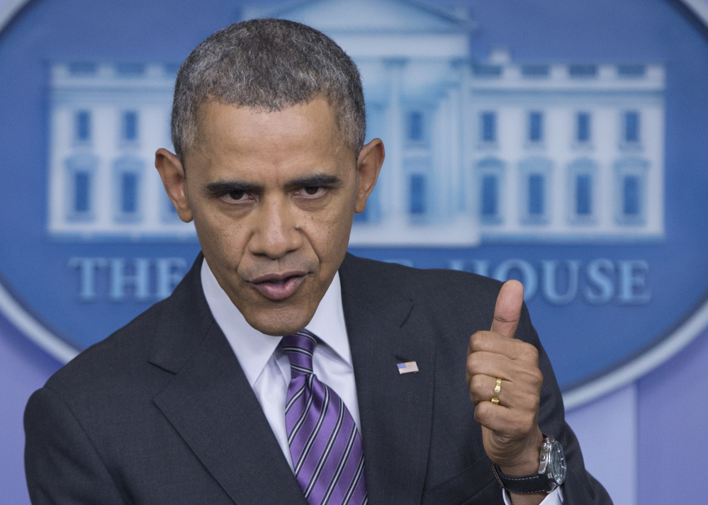 In this April 17 photo, President Barack Obama gestures as he speaks in the White House briefing room in Washington. Blue or red, a majority of states have exceeded their health care sign-up targets under Obama's law, something that would have been hard to imagine after last fall's botched rollout of insurance markets.