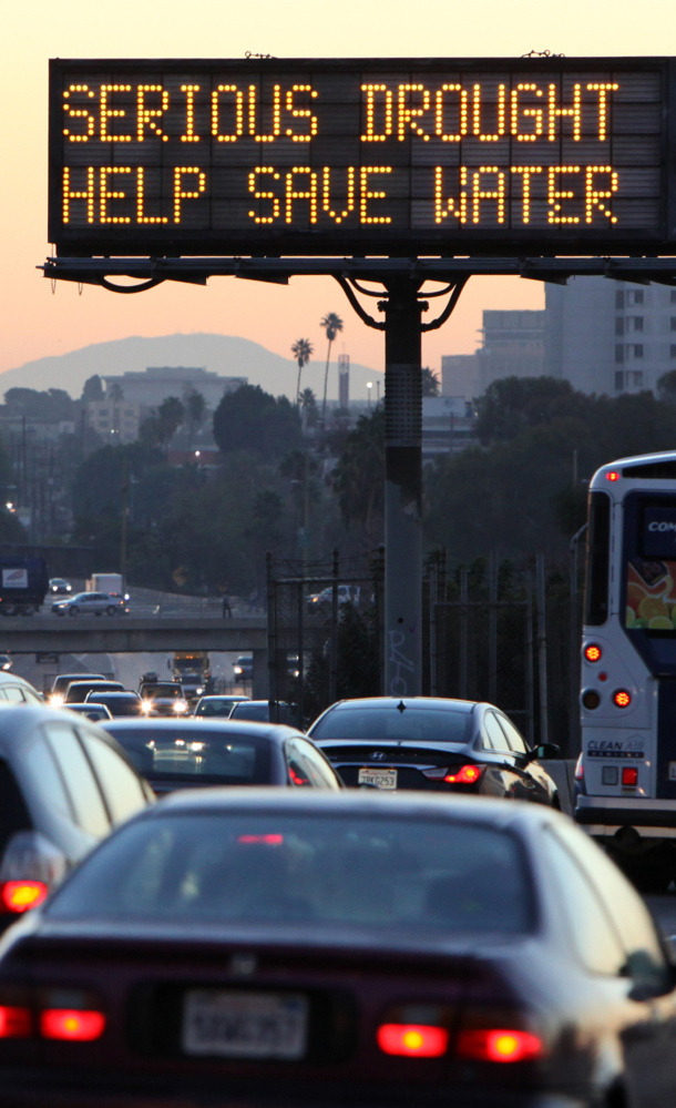 A sign reminds drivers in Los Angeles to conserve water as California faces a withering drought.