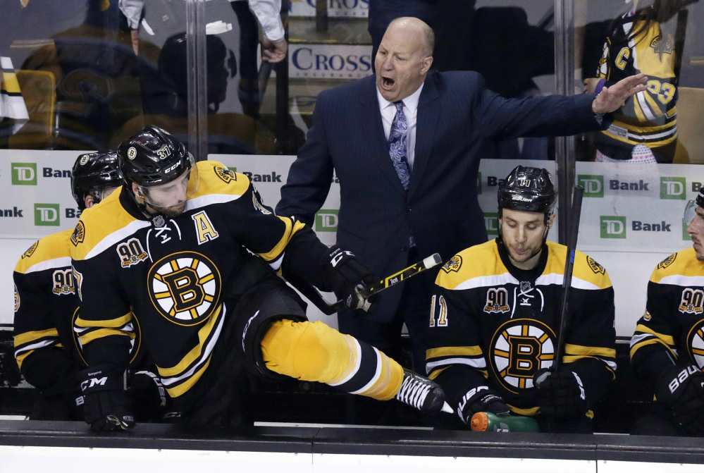 Boston Bruins head coach Claude Julien, center, yells as center Patrice Bergeron climbs over the boards to face the Montreal Canadiens during the third period of Game 1 in the second round of the Stanley Cup playoff series in Boston on Thursday.